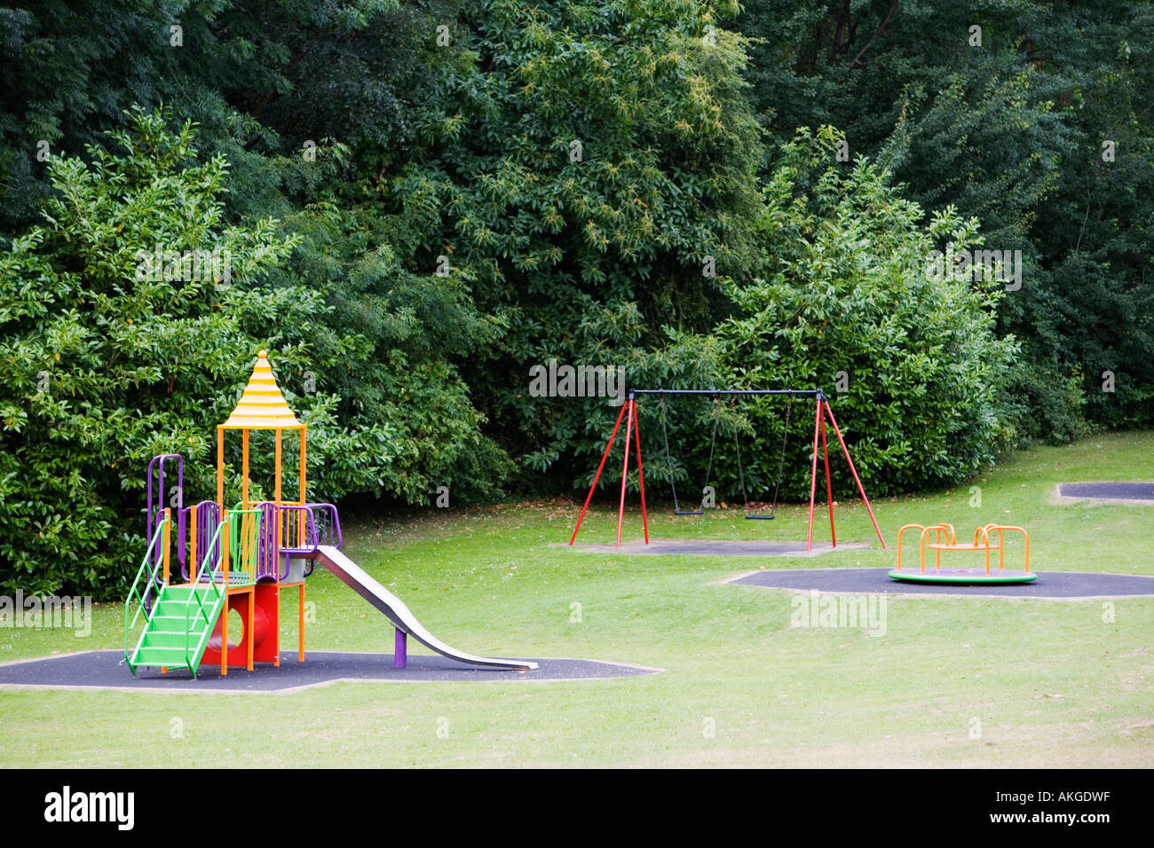 Play Area Grass Park Near Trees Slide Swings And Roundabout