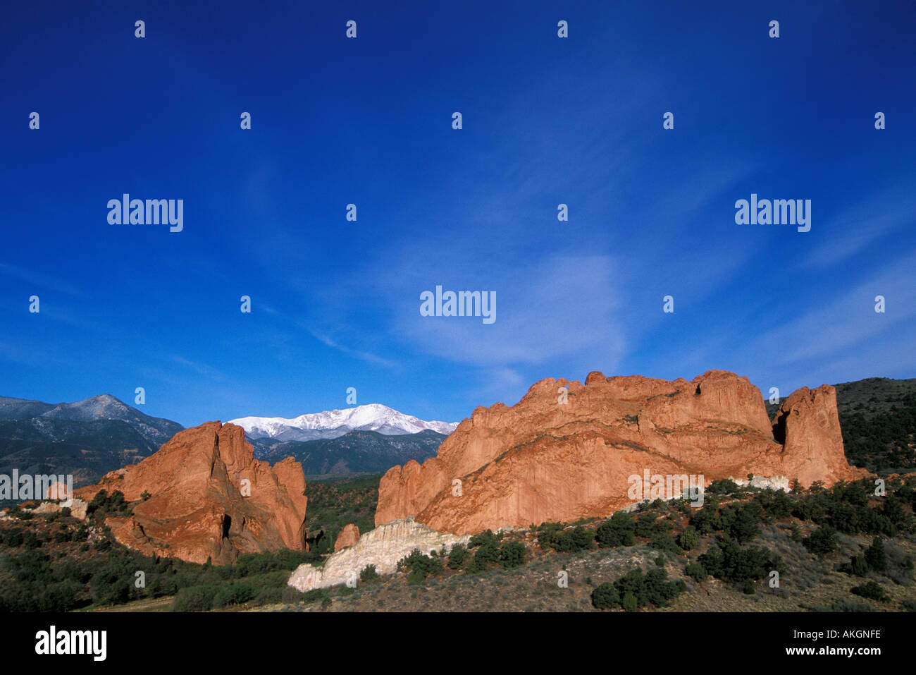 Garden of the Gods rock formations with snow-capped Pikes Peak behind Colorado Springs, Colorado Stock Photo