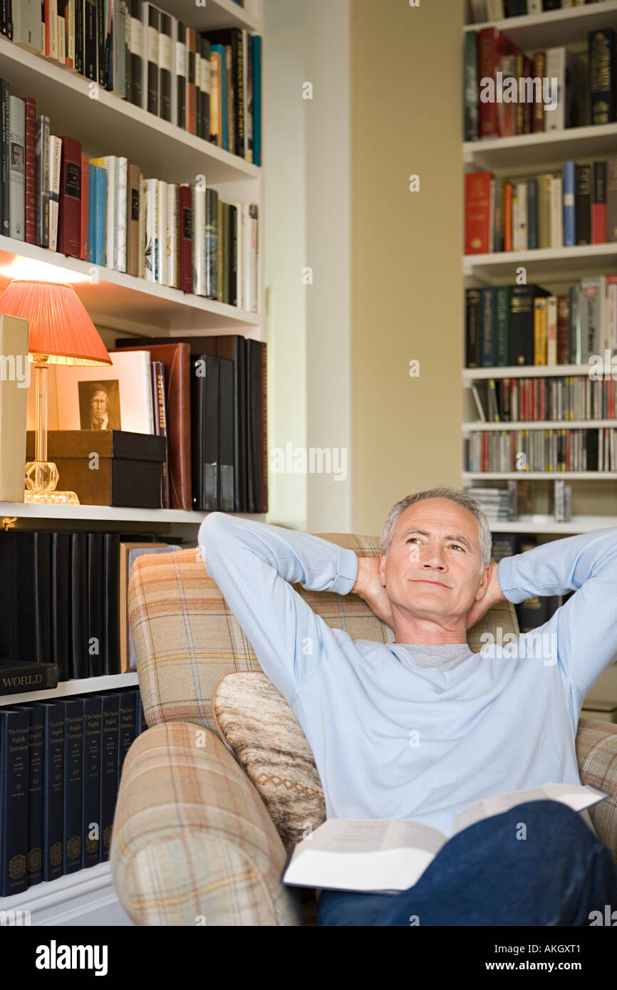 Man relaxing with a book - Stock Image