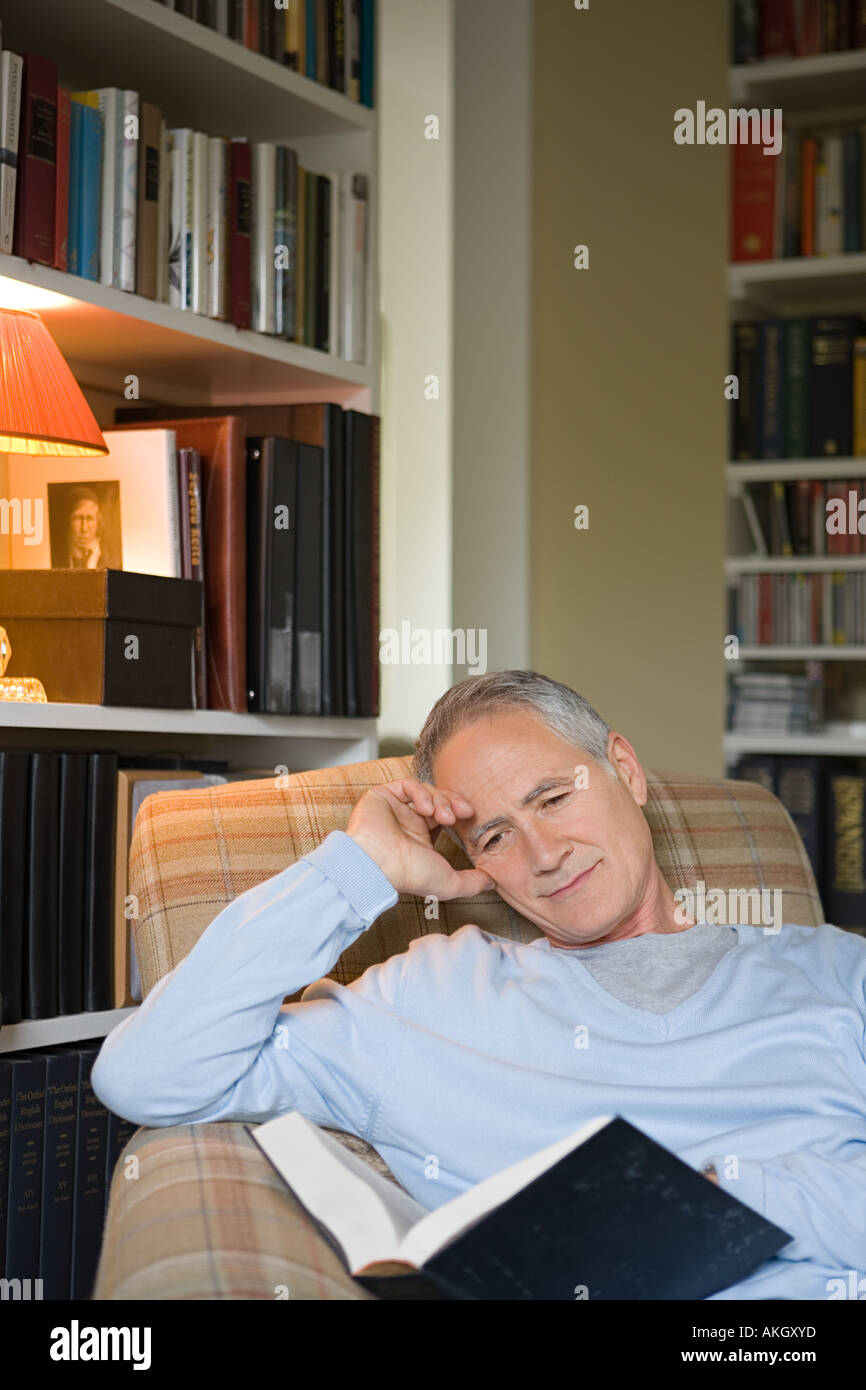 Man reading a book - Stock Image