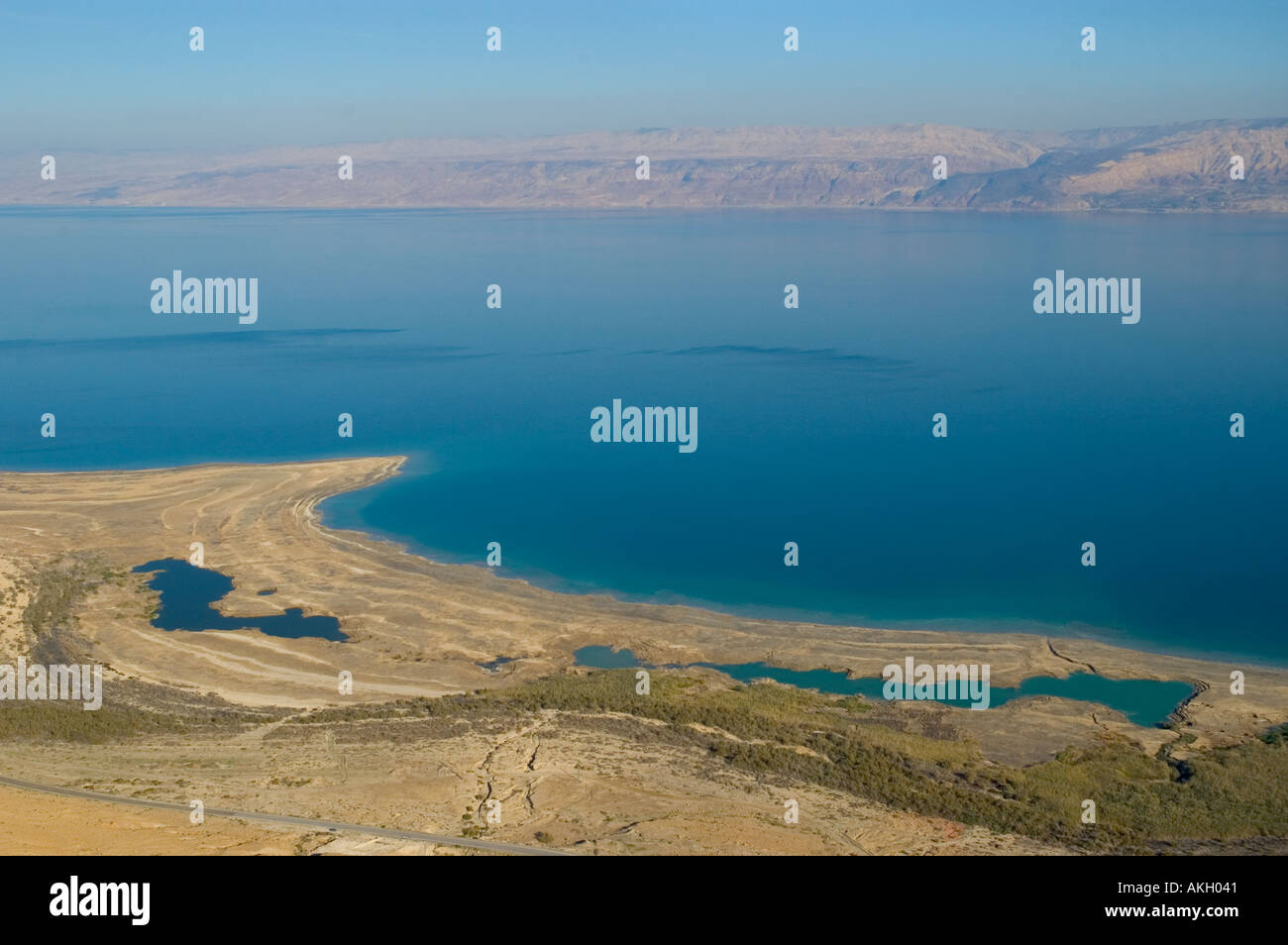 Israel Dead Sea elevated view clearly showing sink holes and successive marks due to receding sea  Stock Photo