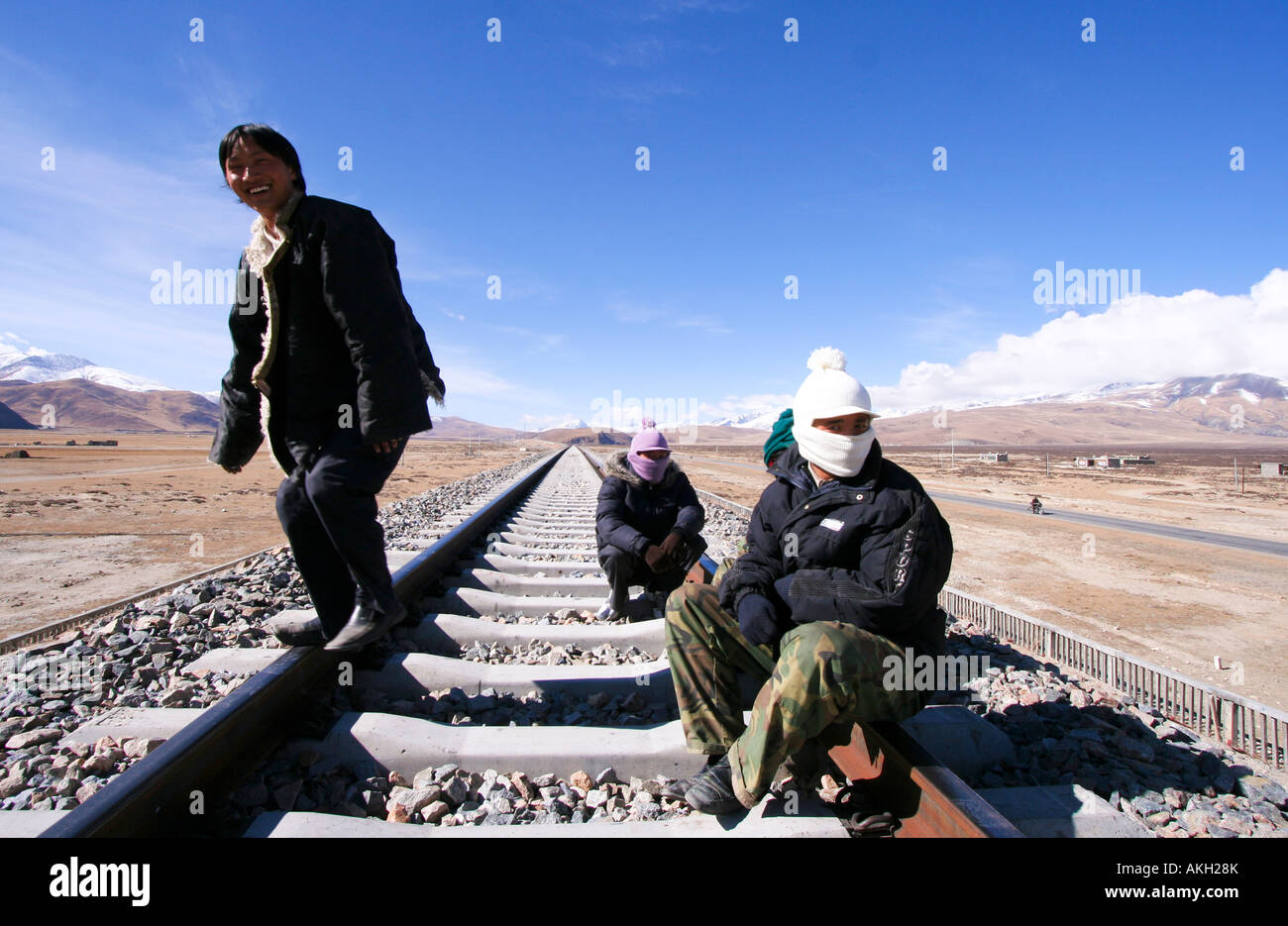 Local Tibetans sitting on the railroad to Lhasa. - Stock Image
