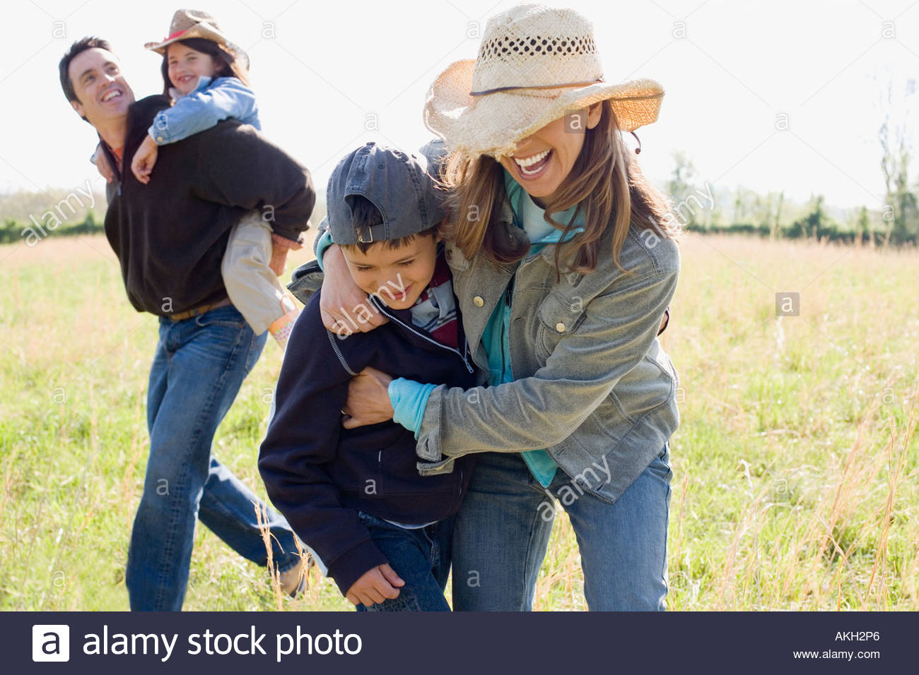 Family playing on field - Stock Image