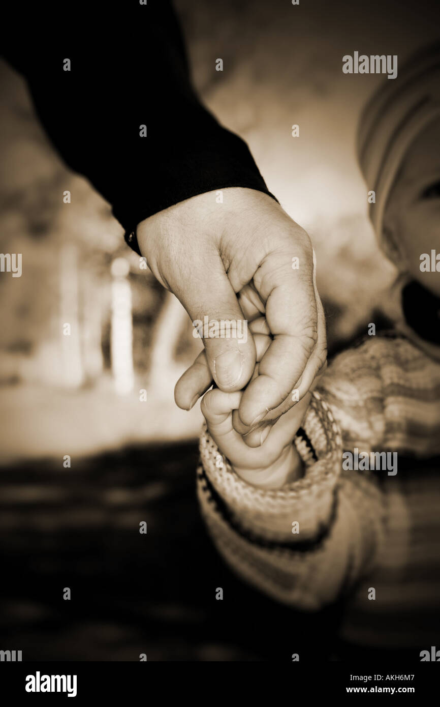 Guidance through the world Holding hand of a child to guide it - Stock Image