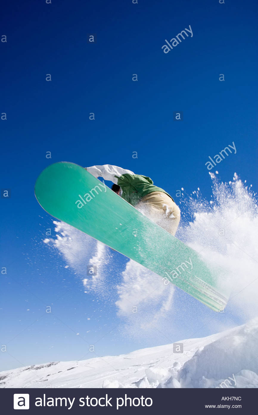 Snowboarder in the air - Stock Image