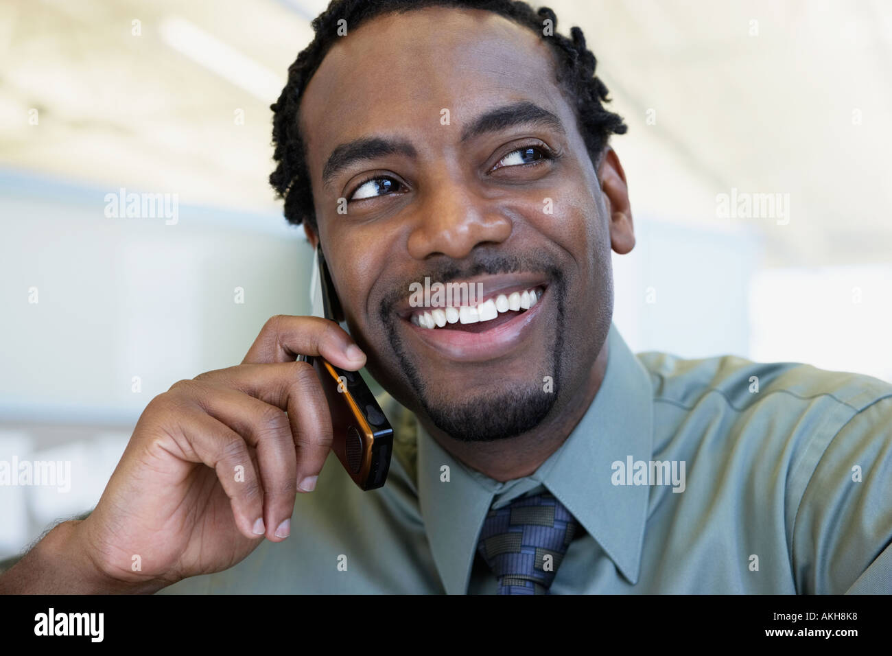 Office worker using a cellular telephone - Stock Image