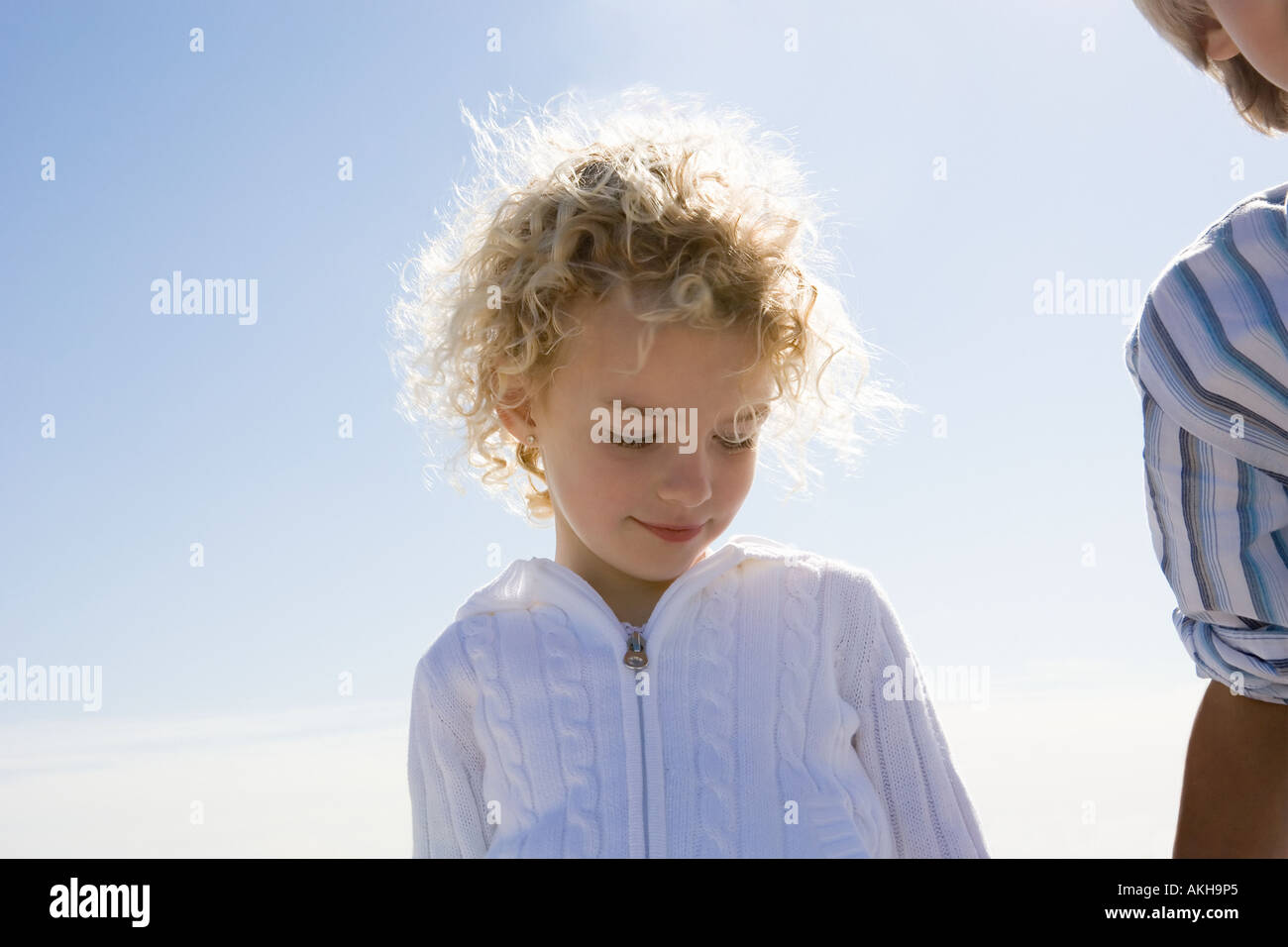 Girl and boy against blue sky - Stock Image
