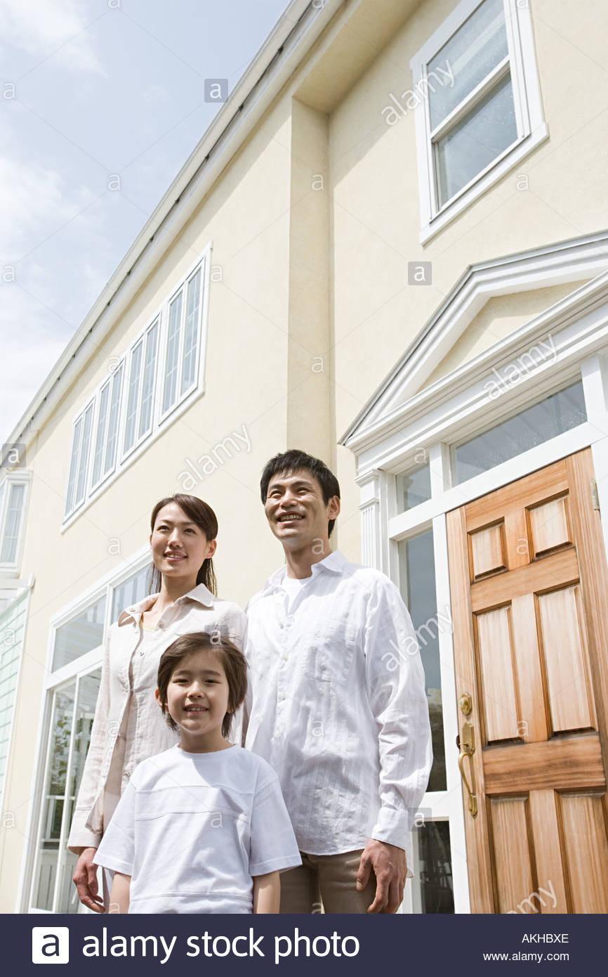 Family outside new house - Stock Image
