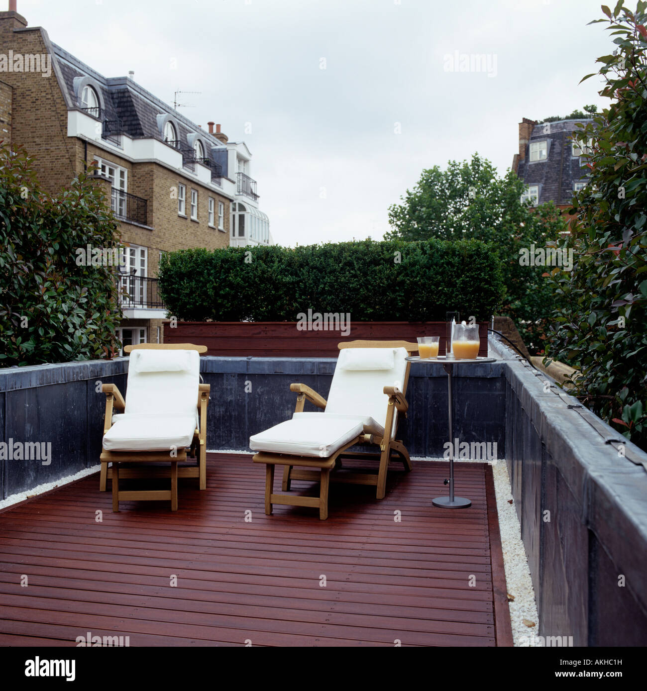 Roof Terrace With Wooden Decking And Sun Loungers
