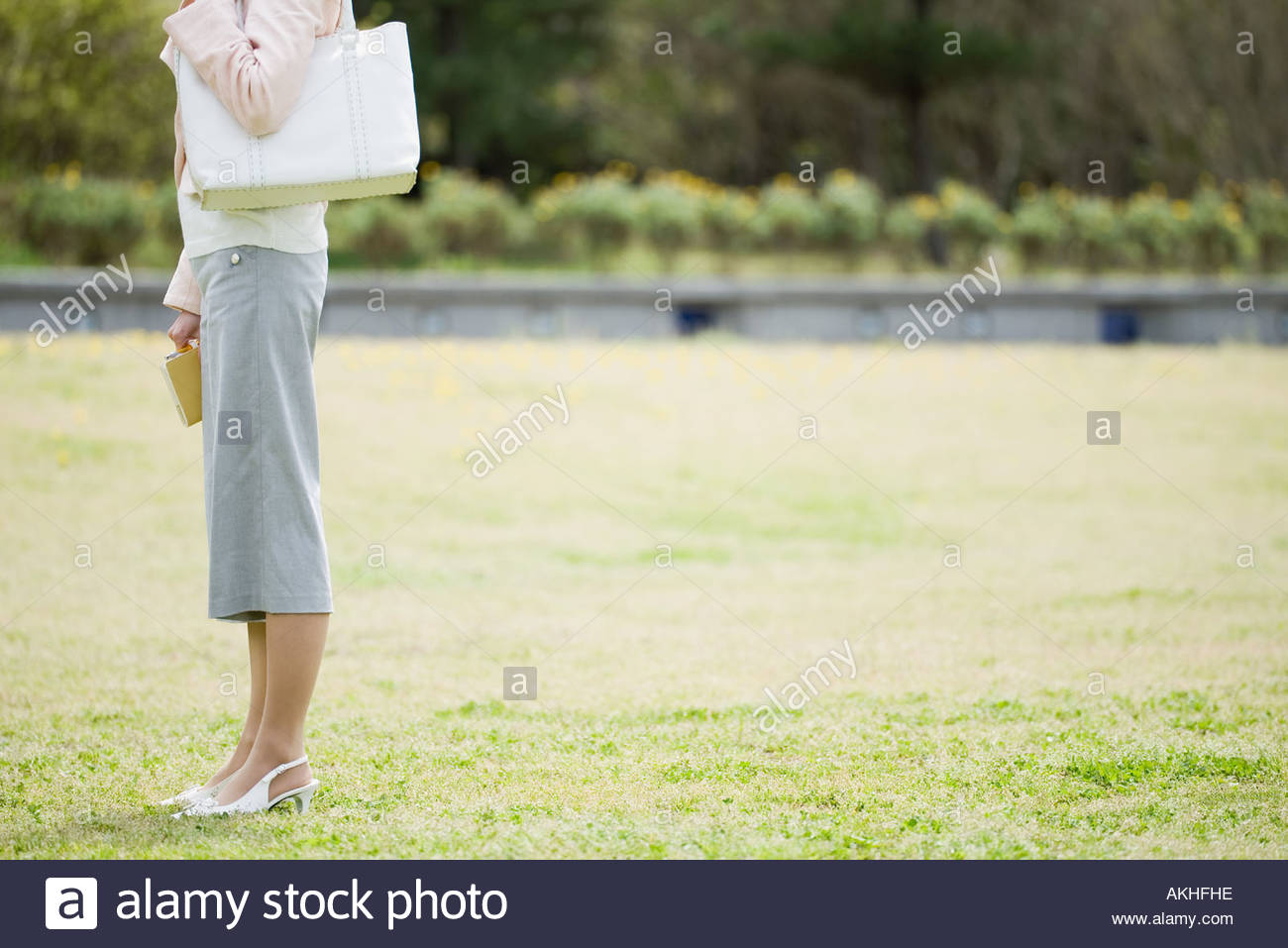 Female office worker in the park Stock Photo