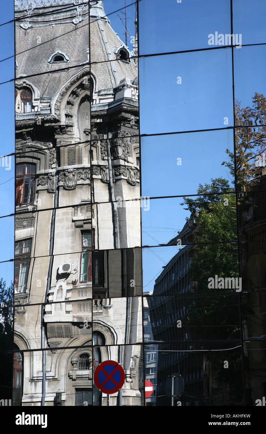 Old building reflected in modern office block Bucharest Romania Stock Photo