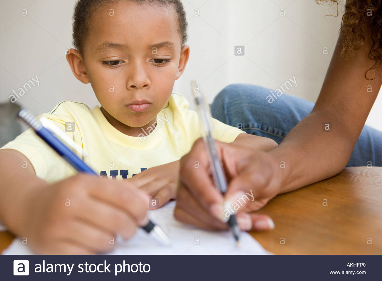 Boy and mother drawing - Stock Image
