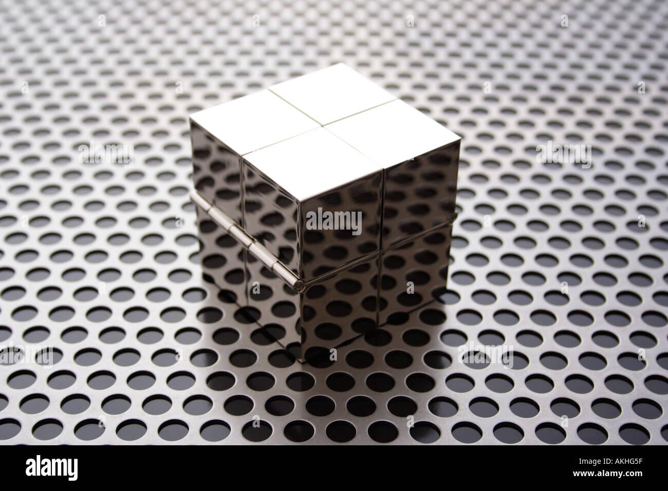 cube on metal grid Stock Photo