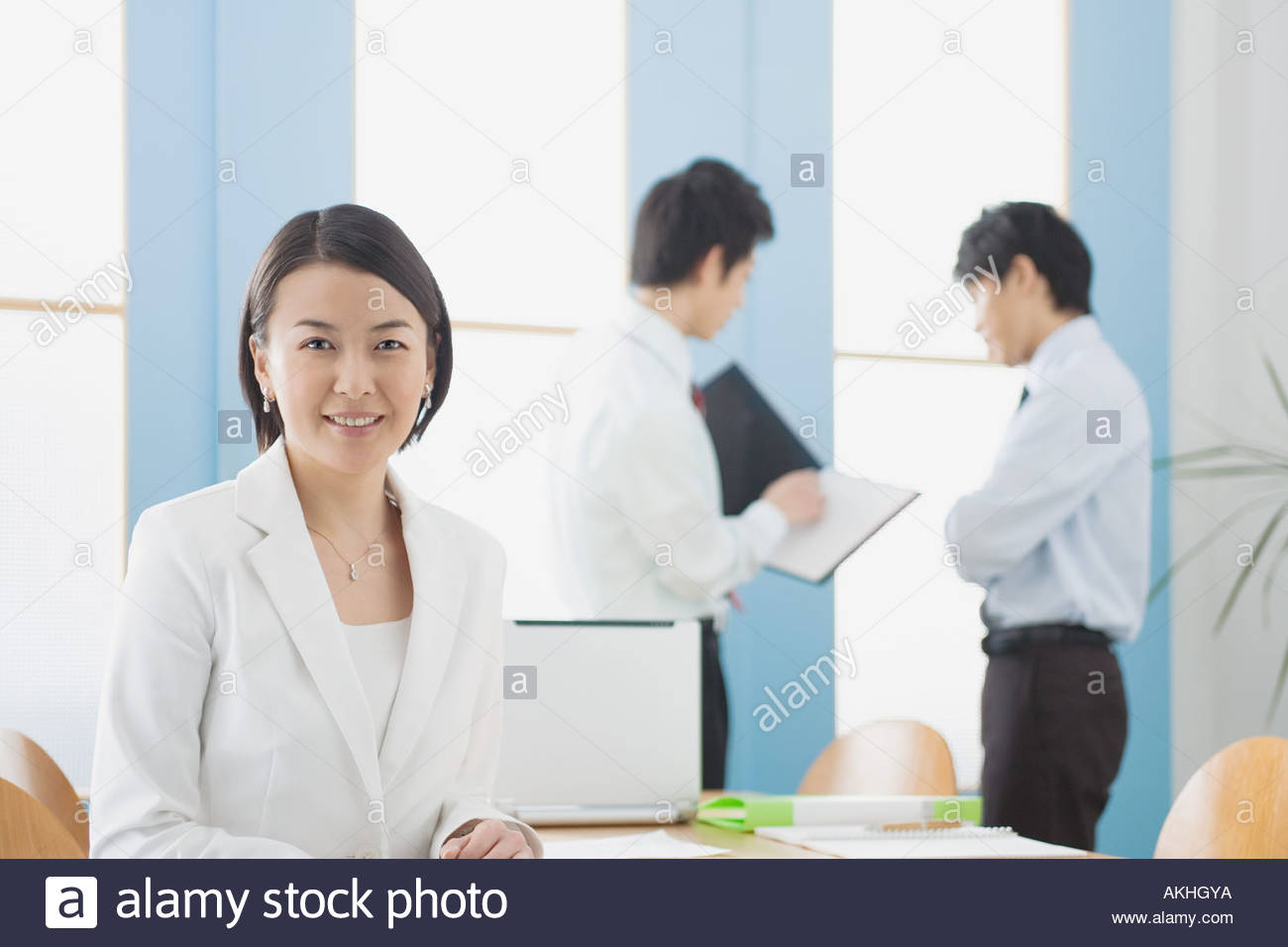Japanese businesspeople in office - Stock Image