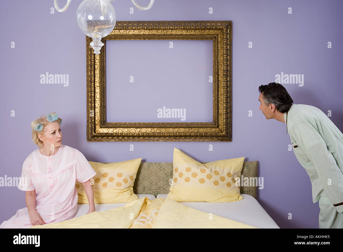 Senior couple arguing in bedroom Stock Photo