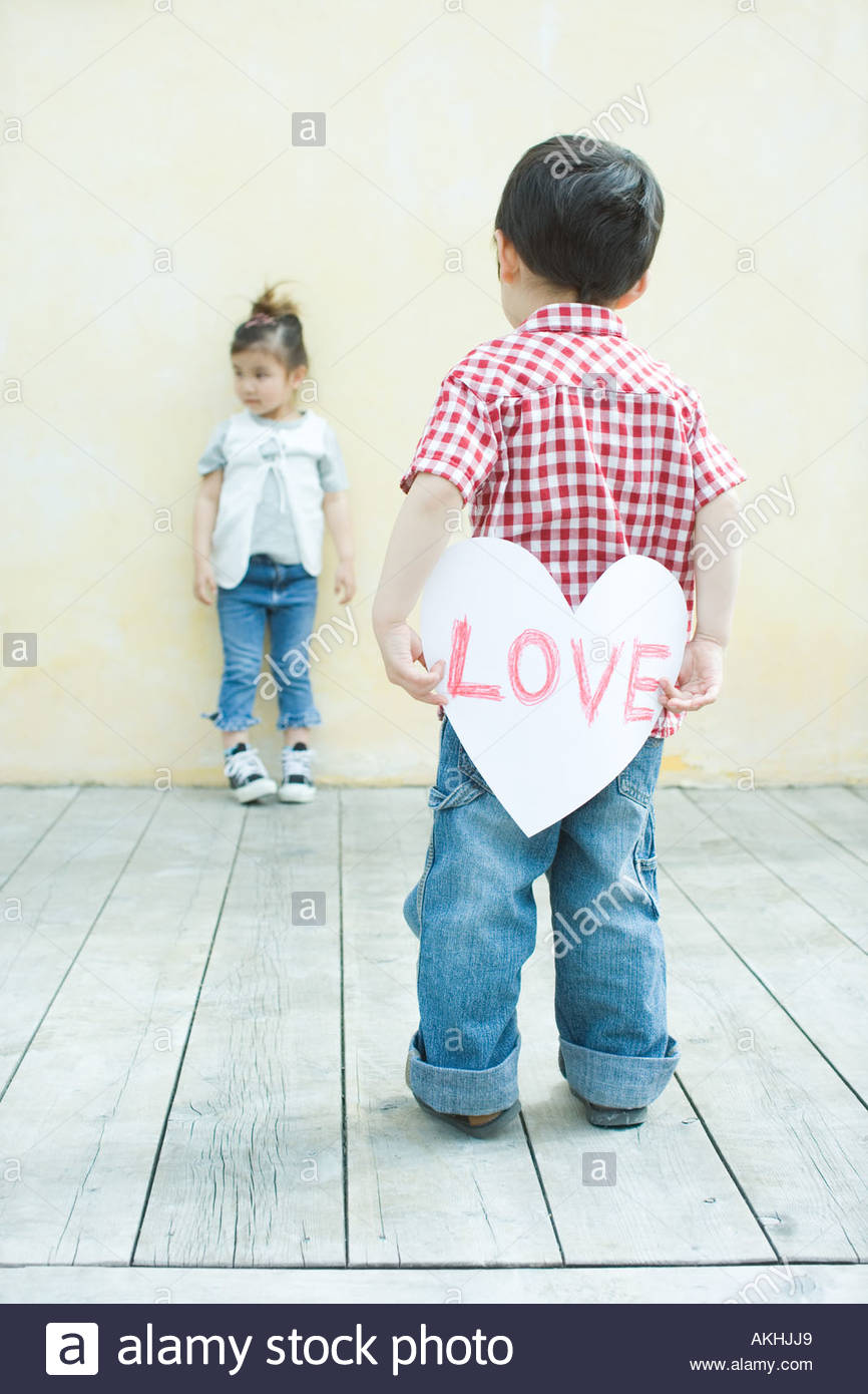 Boy holding a love heart - Stock Image