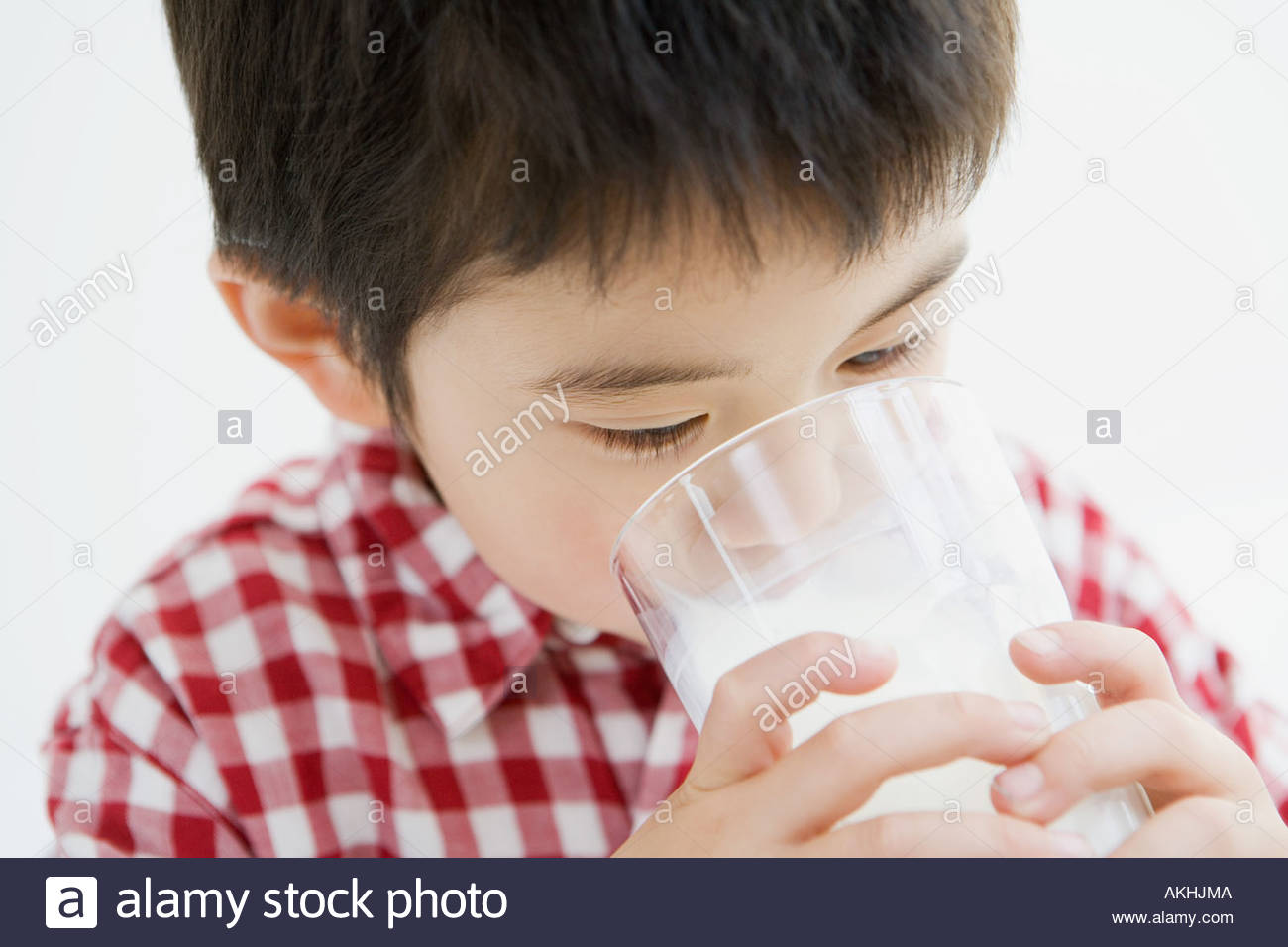 Asian boy drinking milk - Stock Image