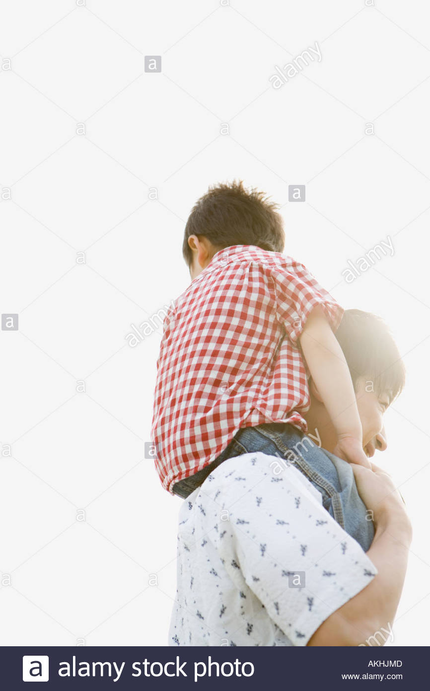 Father shoulder carrying his son Stock Photo