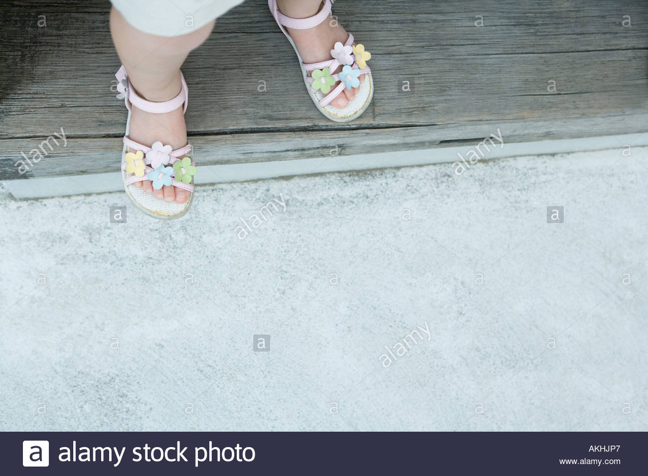 Girl wearing floral sandals - Stock Image