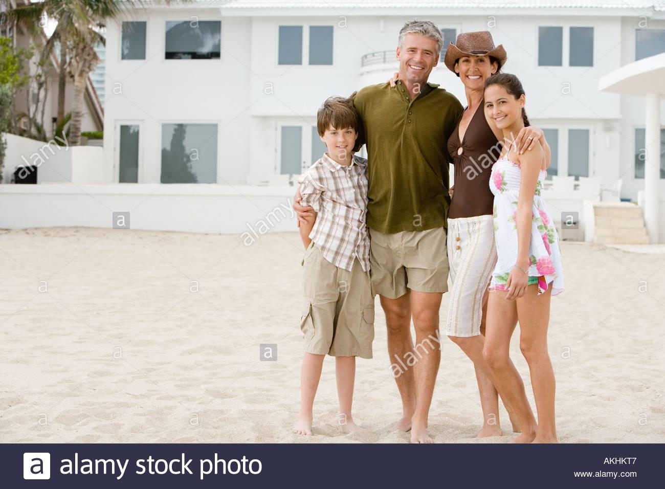 Family at beach house Stock Photo