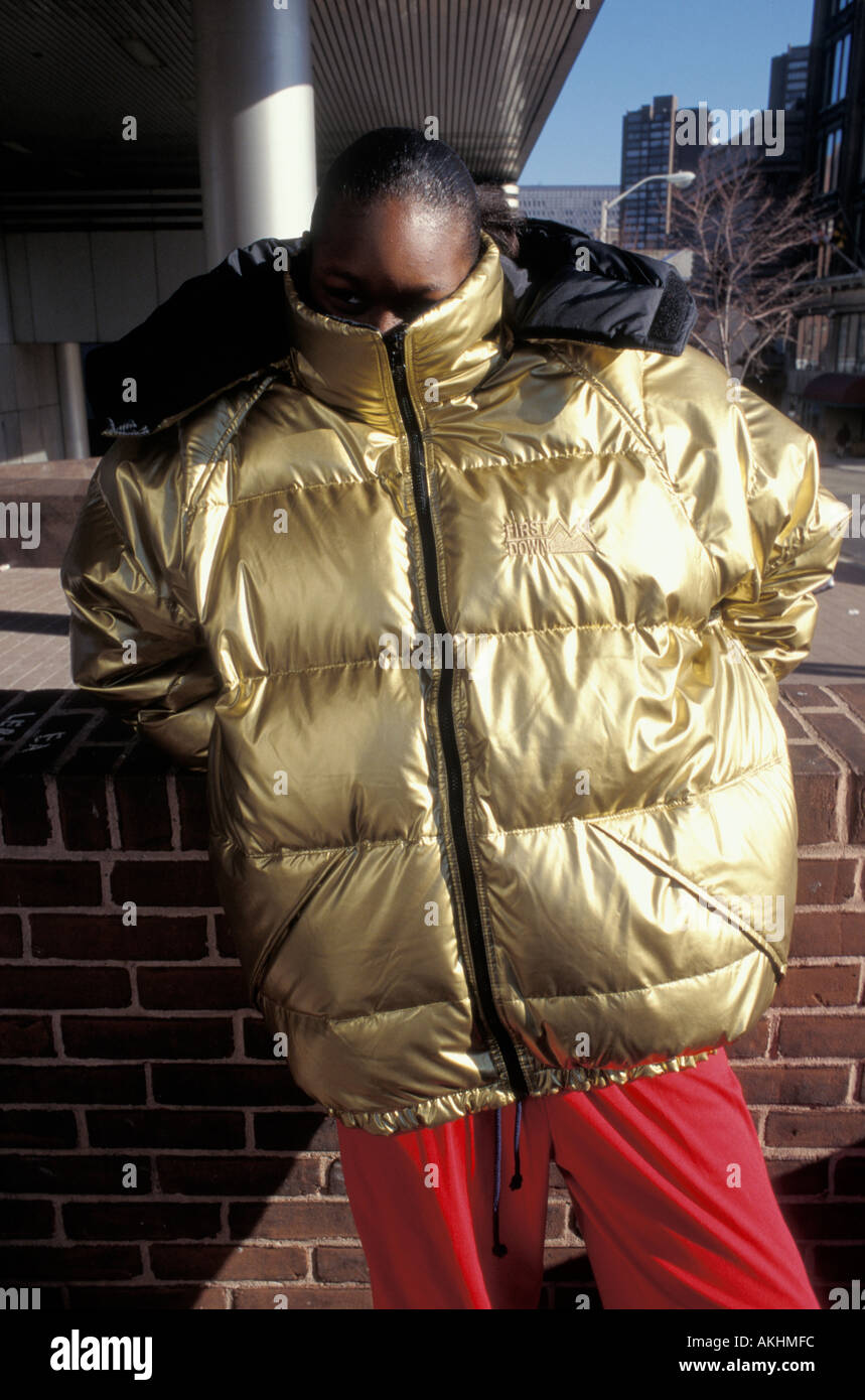 Young black man wearing gold coat Baltimore Maryland 1990s Stock Photo