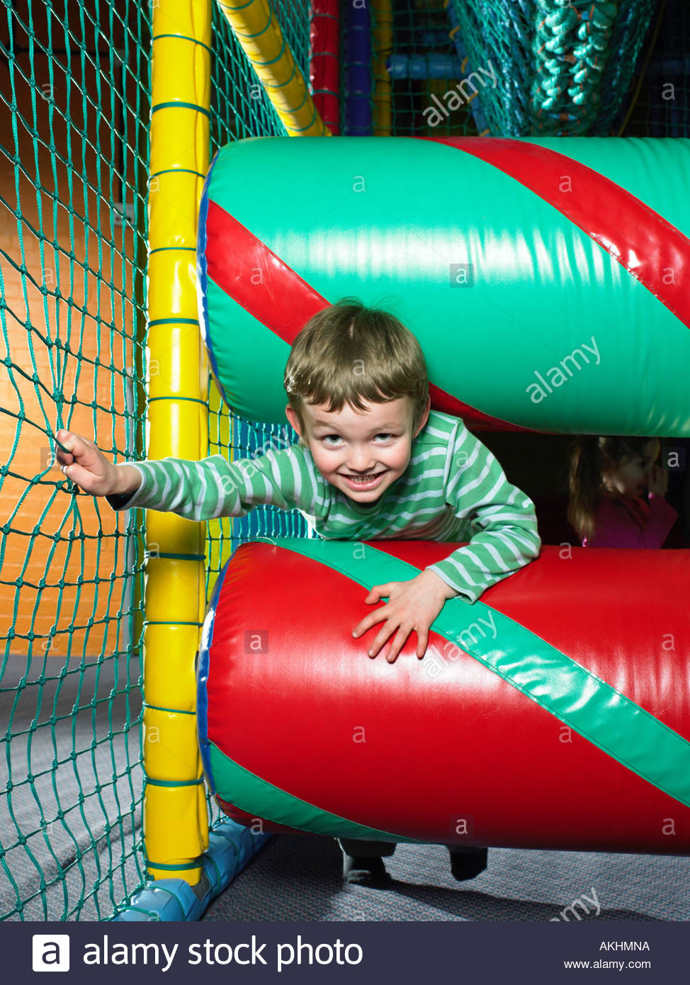Boy in a soft play area - Stock Image