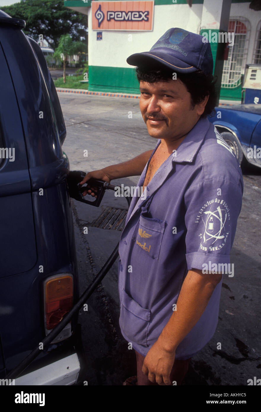 1 one mexican man gas male gas station attendant pumping gas at gas station in san miguel cozumel island quintana roo state mexico