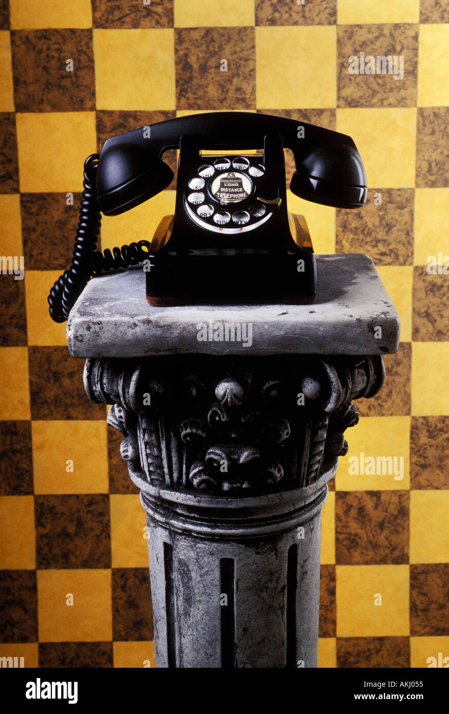 Old telephone on pedestal - Stock Image