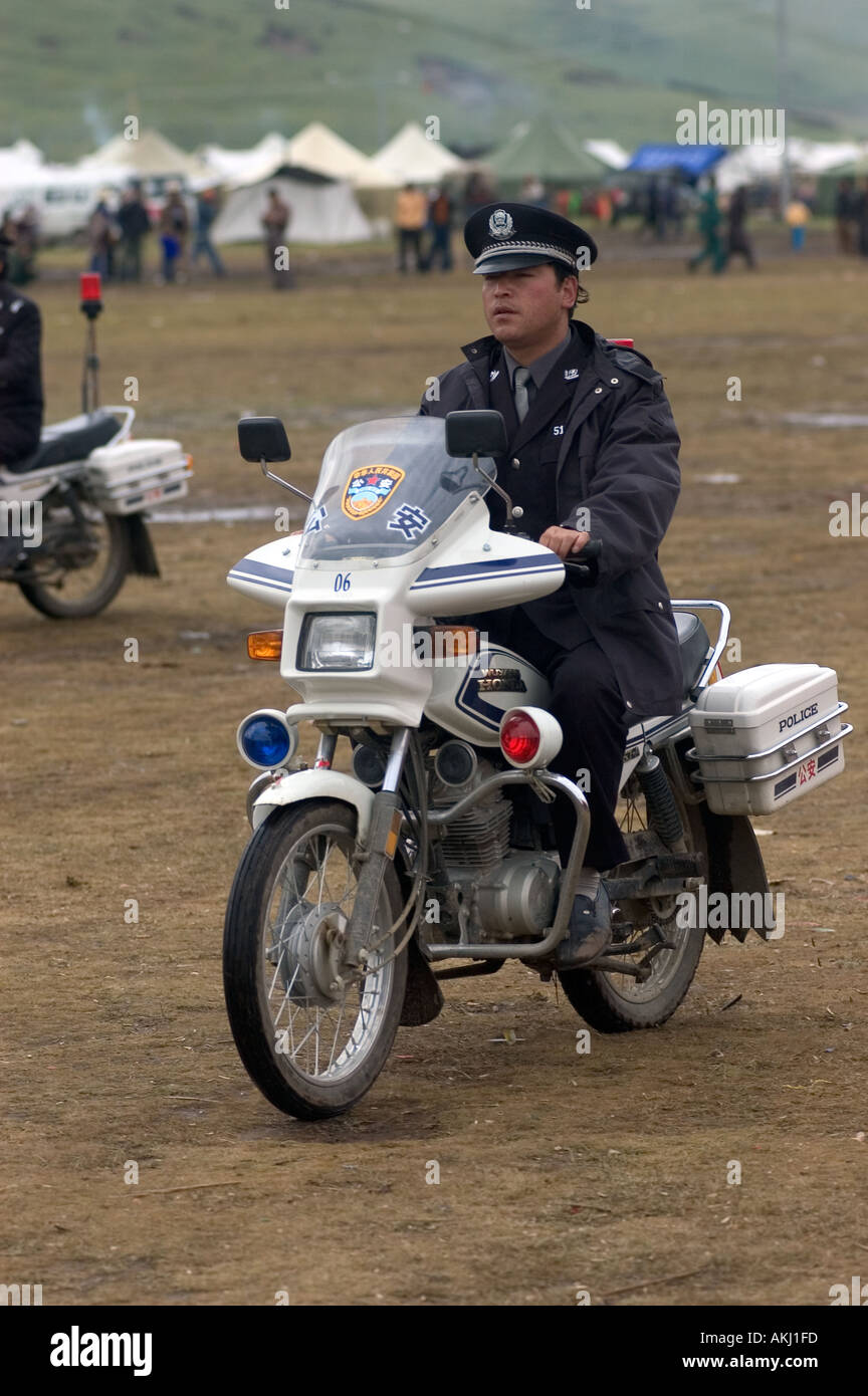 Chinese policeman on motorcycle at the Litang Horse Festival in Kham Sichuan Province China Tibet  - Stock Image