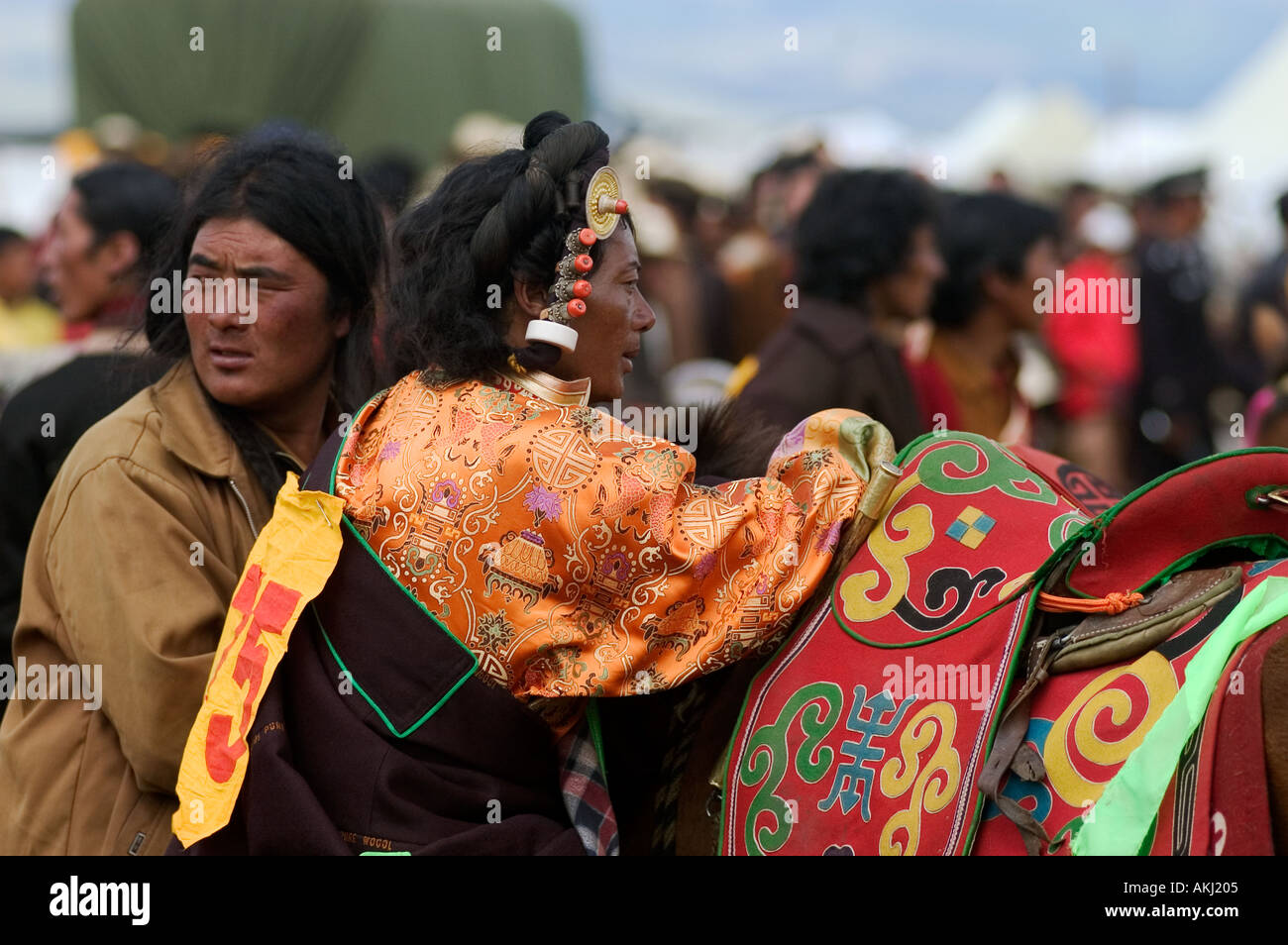 A Khampa prepares to ride at the Litang Horse Festival in Kham Sichuan Province China Tibet  - Stock Image