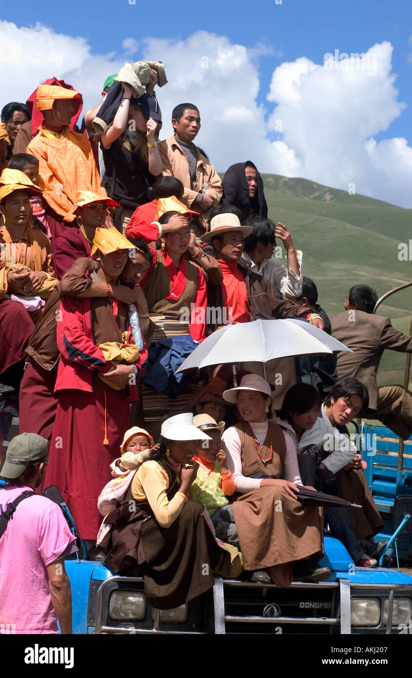 Crowd uses truck as a viewing platform at the Litang Horse Festival in Kham Sichuan Province China Tibet  - Stock Image