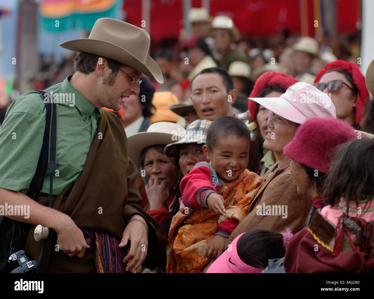 Bodhi talks with the Khampa crowd at the Litang Horse Festival in Kham Litang Sichuan Province China Tibet  - Stock Image