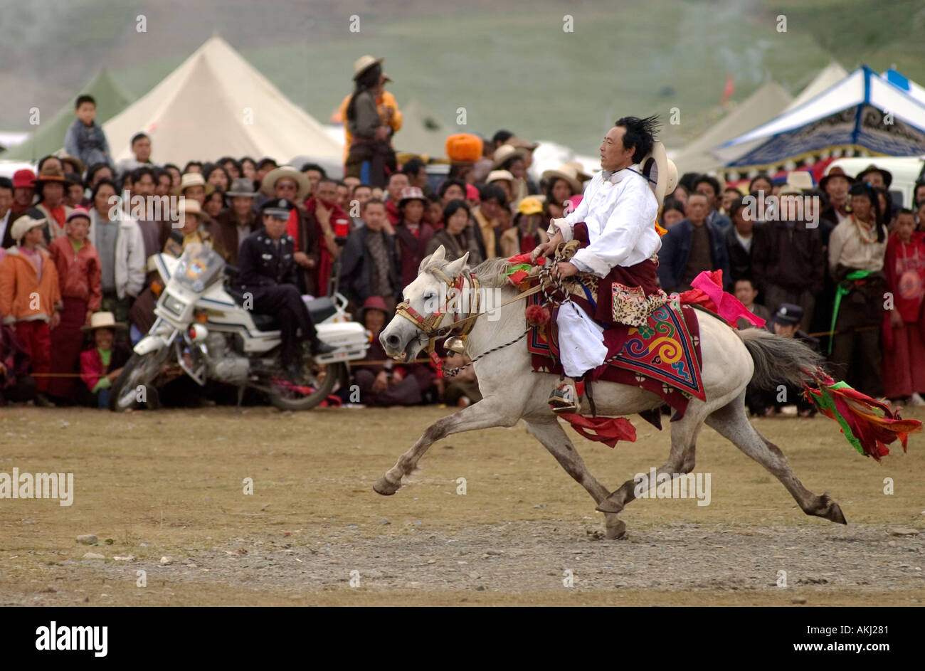 A Khampa participates in the dressage competition at the Litang Horse Festival in Kham Sichuan Province China Tibet  - Stock Image