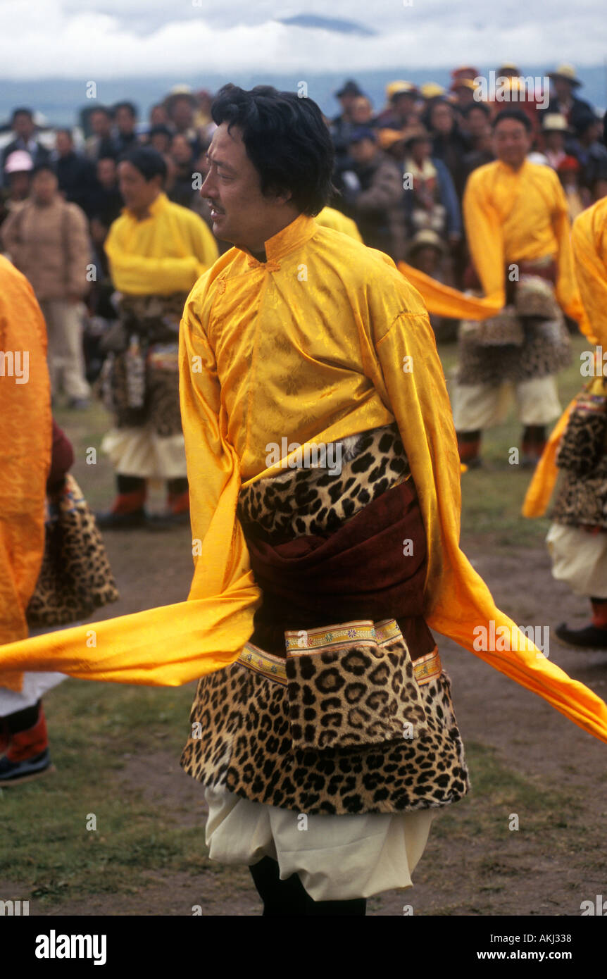 Male dancer with leopard skin costume representing a region of Kham Litang Horse Festival Sichuan Province China - Stock Image