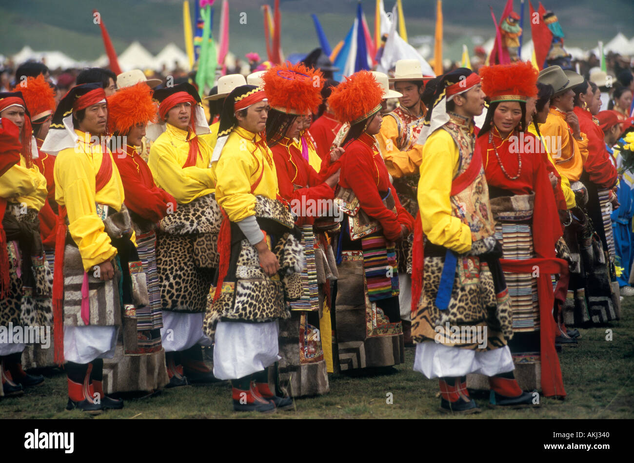 Dance troop with leopard skin costumes represent a region of Kham Litang Horse Festival Sichuan Province China - Stock Image