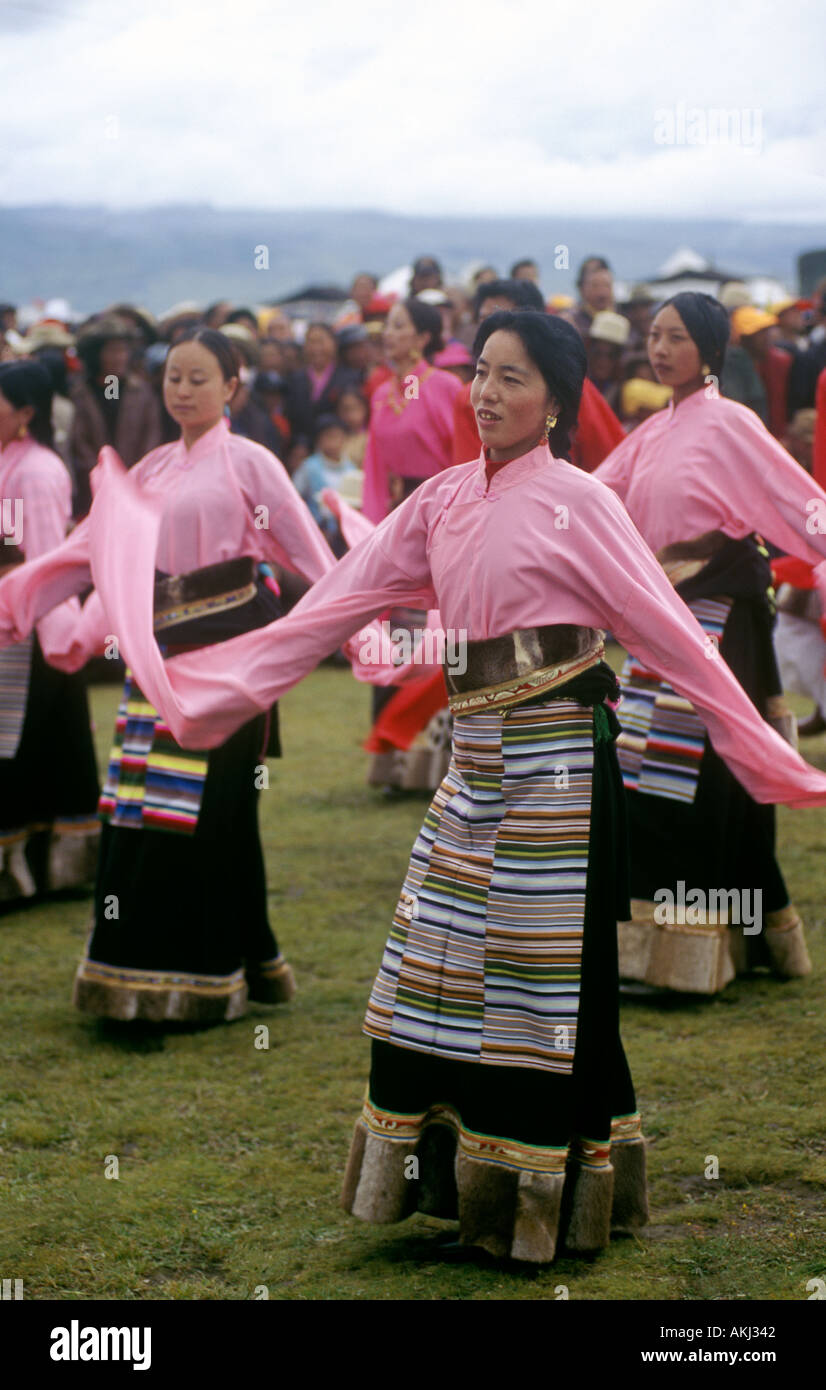 Female Dance troop with otter fur lined chubas preform at the Litang Horse Festival Kham Tibet Sichuan Province China - Stock Image