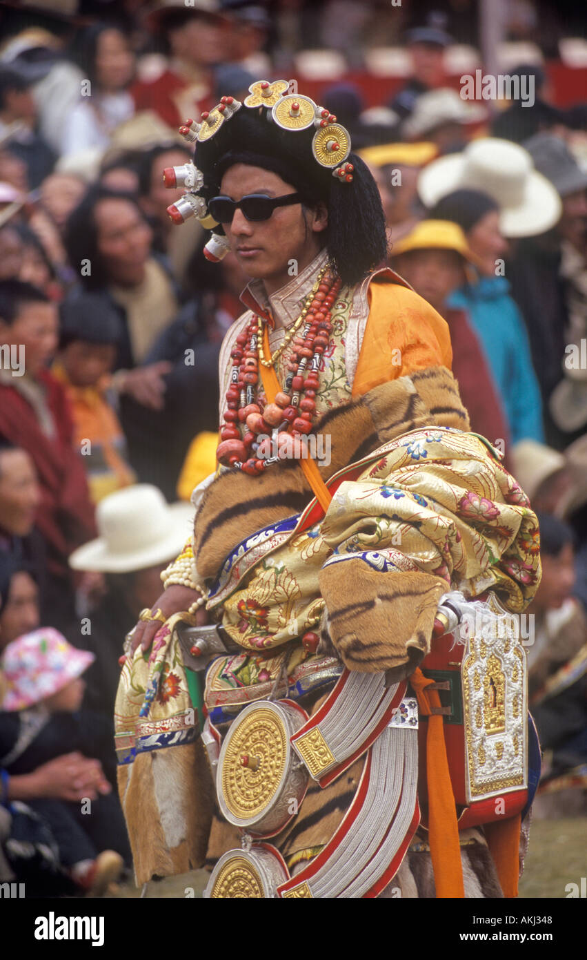 Male Khampa wear tiger skins coral zees gold hair pieces at the Litang Horse Festival Sichuan Province China Tibet Stock Photo