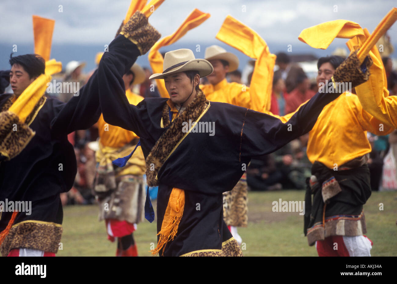 Dance troop with otter skin costumes represent a region of Kham Litang Horse Festival Sichuan Province China - Stock Image