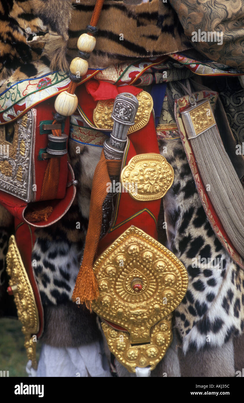 Male Khampa wears leopard skin knife gold as wealth display at the Litang Horse Festival Sichuan Province China Tibet  - Stock Image