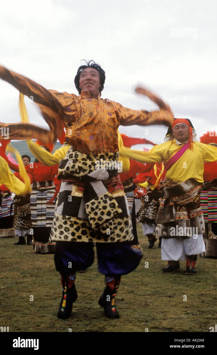 Dance troops preform at the Litang Horse Festival representing various regions of Kham Sichuan Province China Tibet  - Stock Image