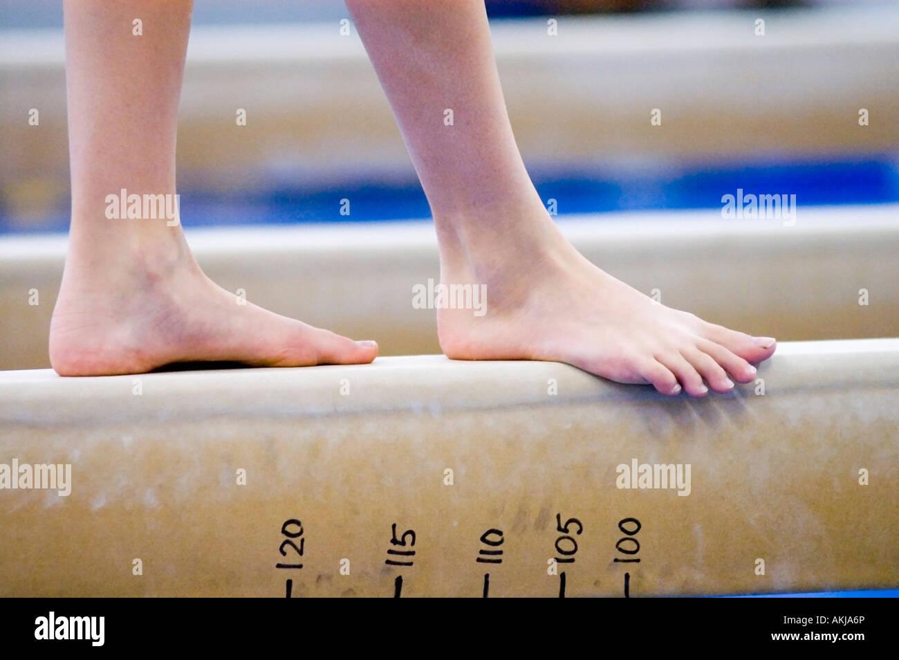 An athlete training on the beam - Stock Image