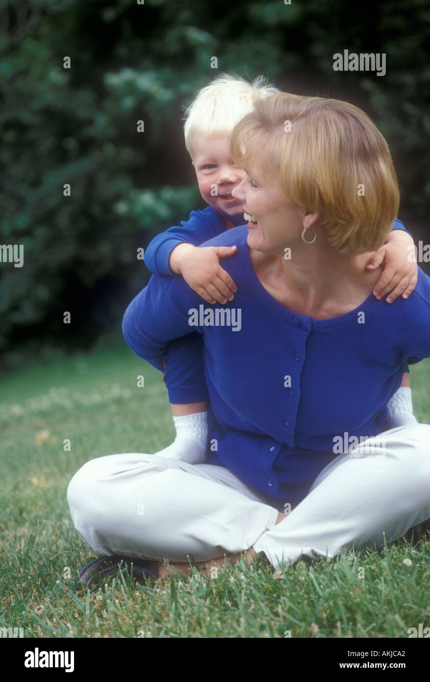 Boy on Mom's Back Stock Photo