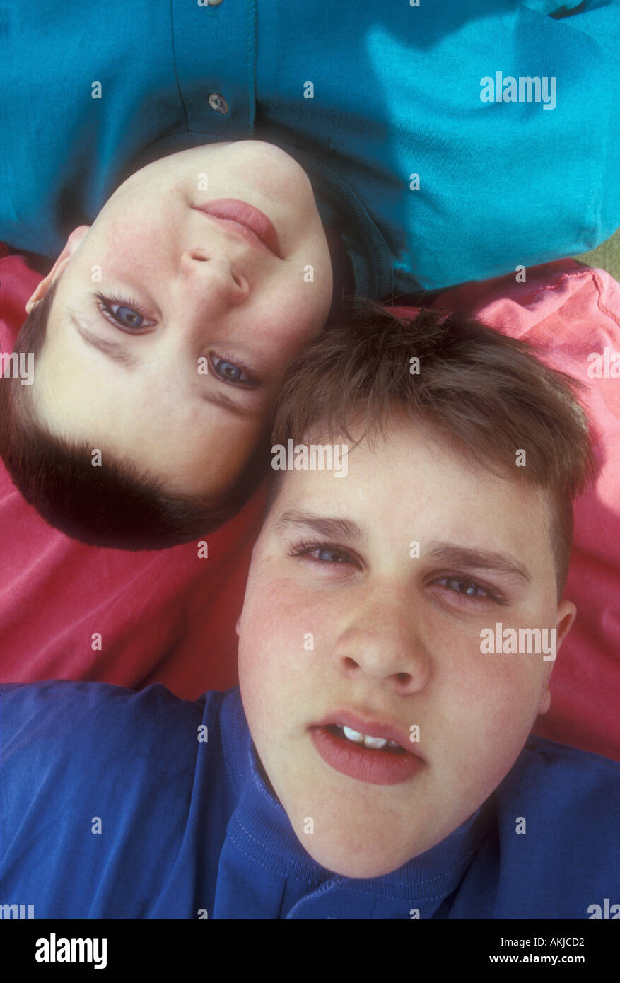 Boy's Heads touching Upside Down - Stock Image