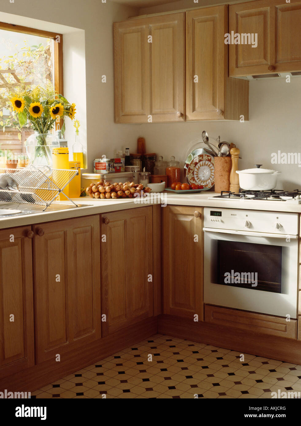 White Oven In Traditional Pine Kitchen With Yellow Sunflowers On The Stock Photo Alamy