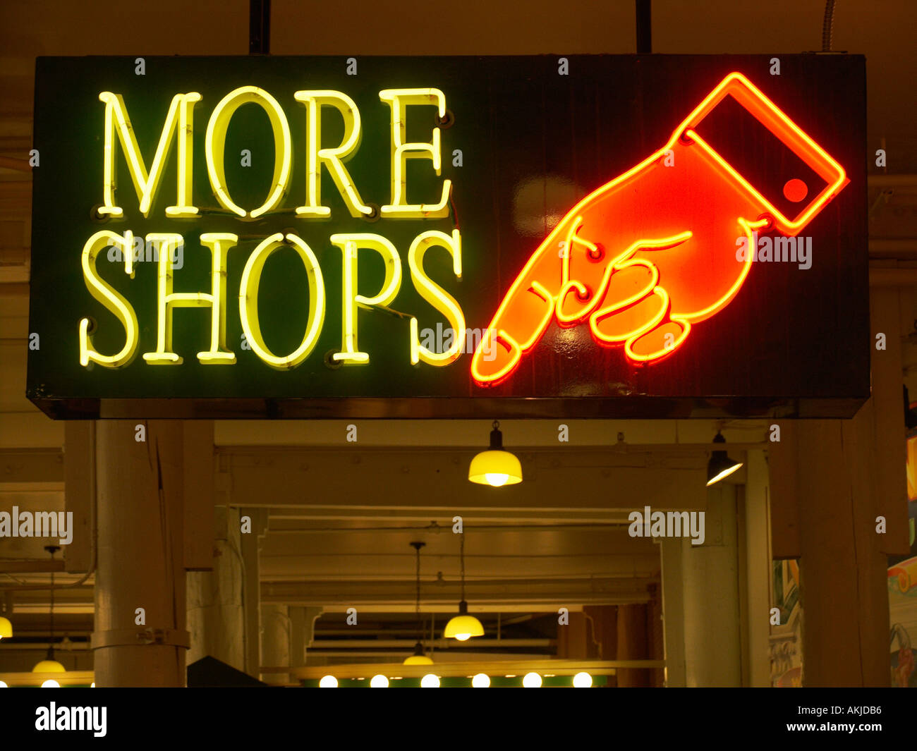 Neon sign of hand pointing to more shops in the Down Under at the Pike Place Market Seattle Washington USA - Stock Image
