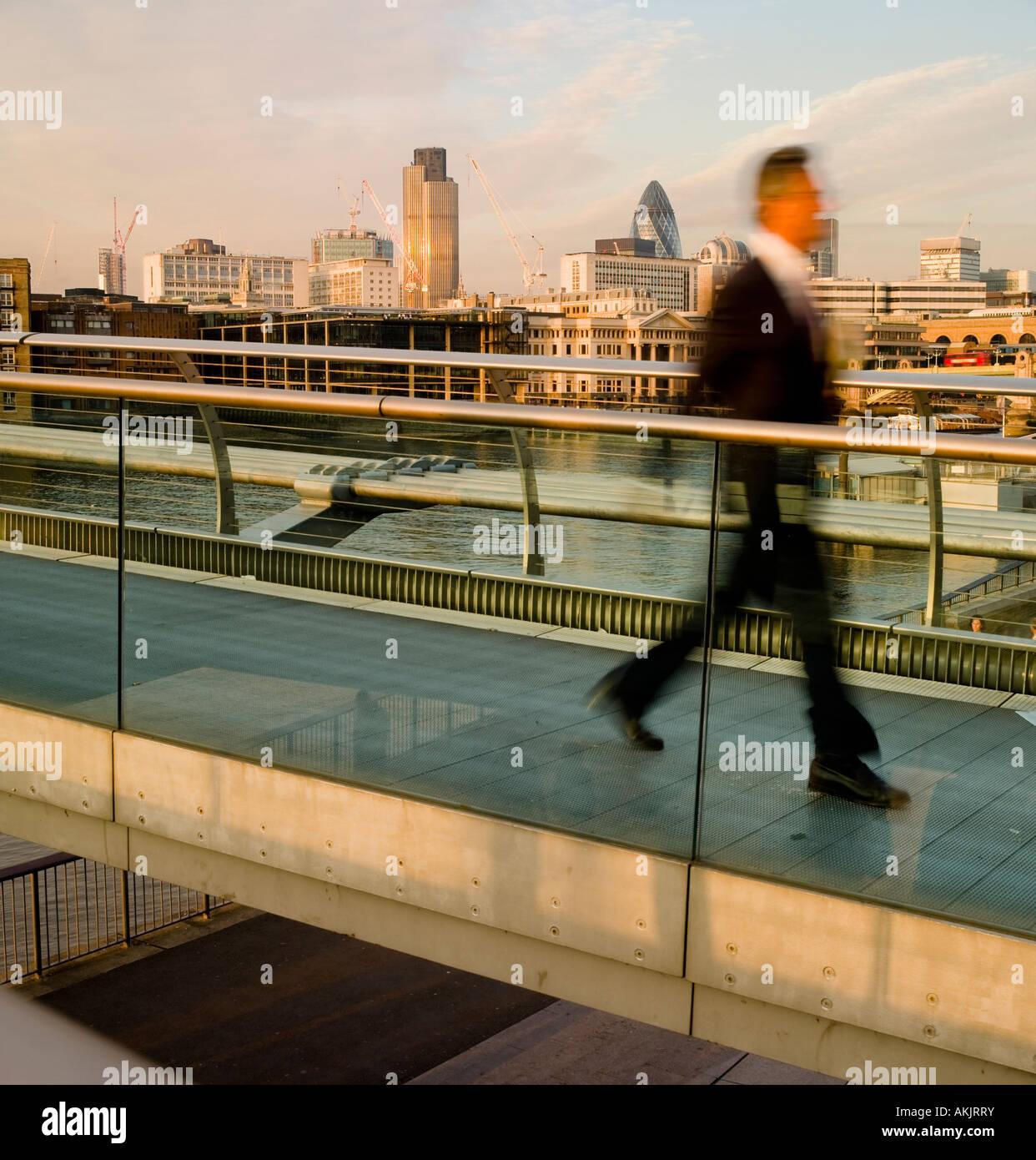 Crossing millennium bridge towards bankside London No model release as movement blur side view means person is unrecognizable Stock Photo