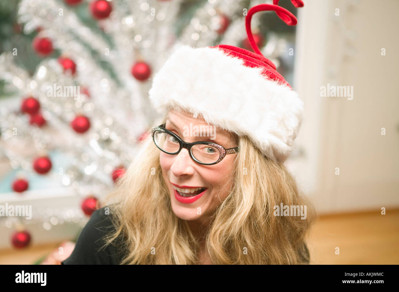 Portrait of playful woman at Christmastime - Stock Image