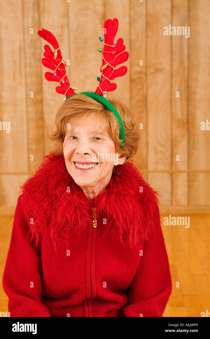 Portrait of elderly woman at Christmastime - Stock Image