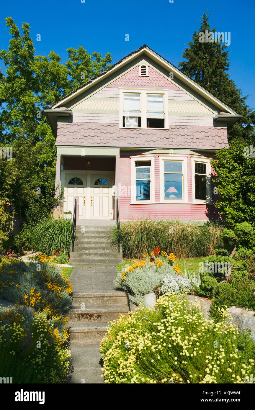 Front of duplex with trees and gardens - Stock Image