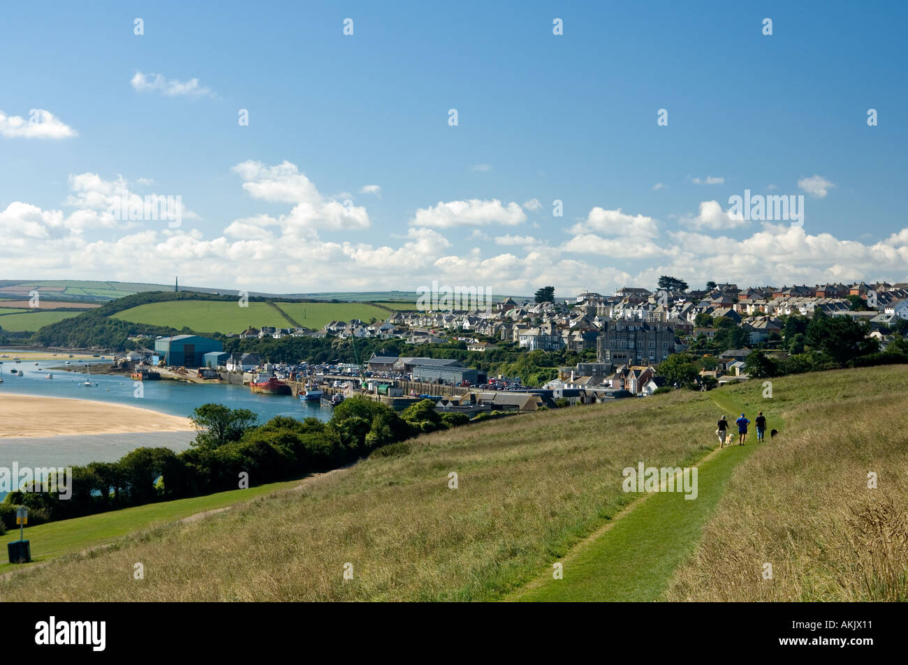 The scene overlooking Padstow from the clifftop path which meanders along the cliffs towards many golden beaches - Stock Image